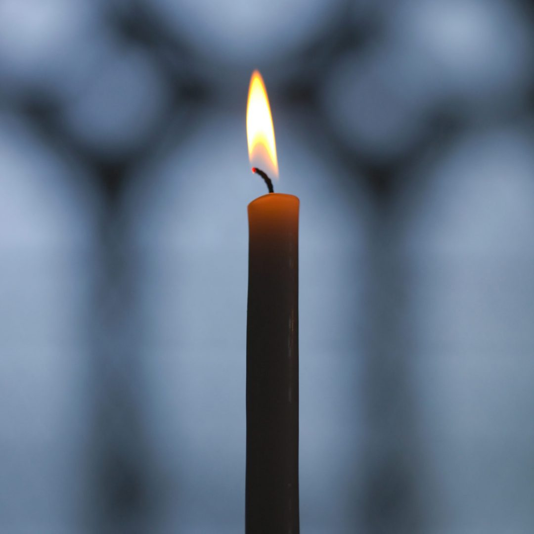 Flame of a candle in a church